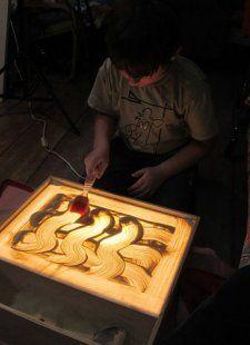 Рисование на песке кисточкой